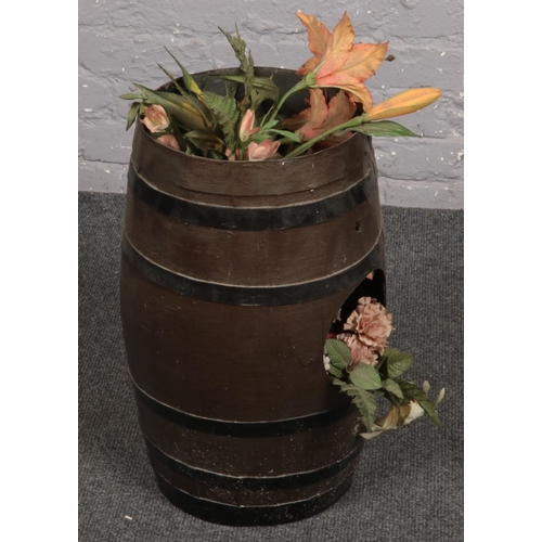 506 - A Plastic Beer Barrel with Artificial flowers. Provenance; Lathom Hall Liverpool....