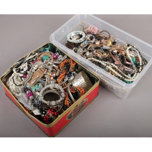 105 - Two boxes of costume jewellery, to include bangles, beads, earrings etc....