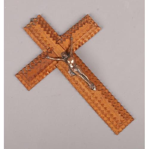 141 - A tramp art crucifix surmounted by a figure of Christ, 20cm....