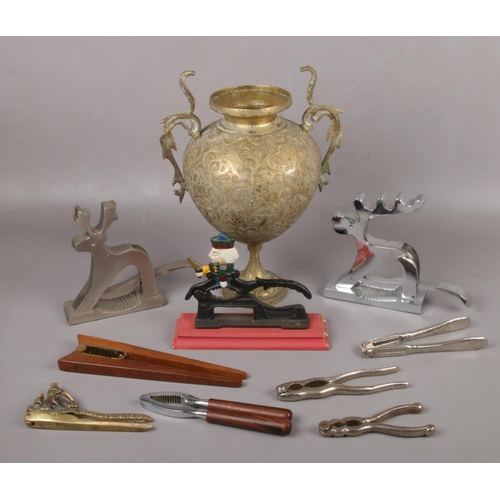 168 - A 19th century Indian bidri ware brass vase and a collection of nut crackers....