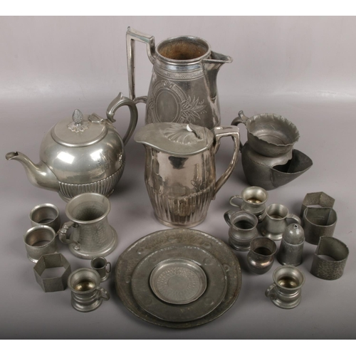 227 - A box of pewter to include teapot, jug, serviette rings etc....