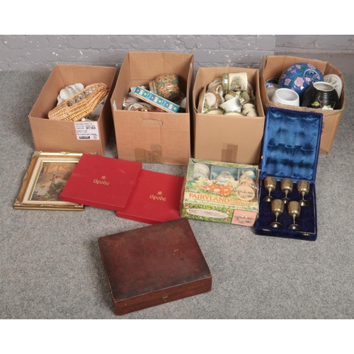 261 - Four boxes of miscellaneous to include box set of silver plate goblets, dinnerwares, oriental wares,...