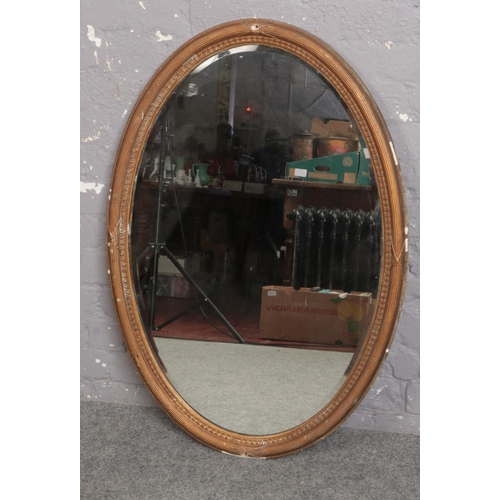 326 - An oval bevel edge mirror ( approx 67 cm x 100 cm)...