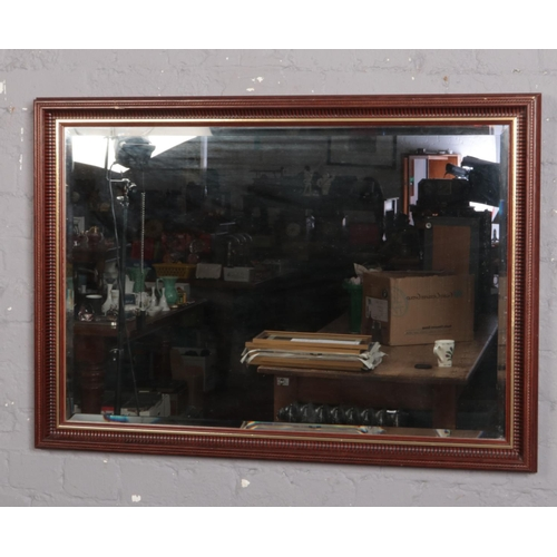 331 - A large bevel edged wall mirror in 70cm x 100cm....