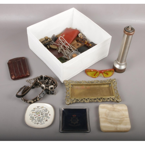 46 - A box of collectables to include flash light, metal trinket dish, sunglasses, leather collars etc....