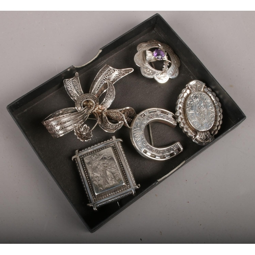 361 - Five silver brooches to include Victorian example etc....