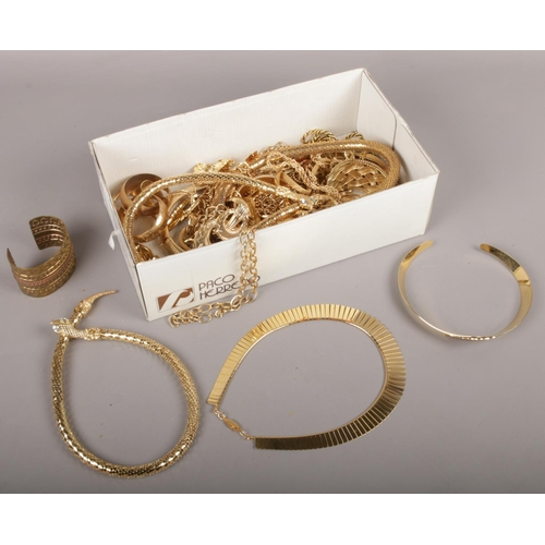 47 - A box of gold plated jewellery to include necklaces, bangles, bracelets etc....