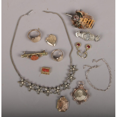 380 - A small box of vintage costume jewellery to include rings, brooches, necklace etc....