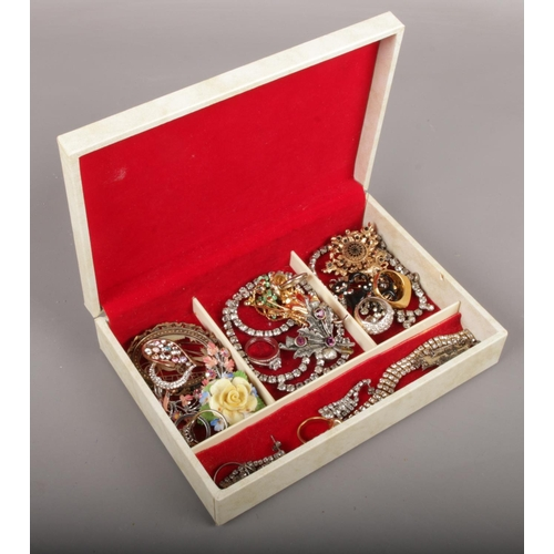 52 - A jewellery box of costume jewellery to include white and coloured paste stone examples etc....