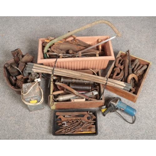 478 - A large collection of vintage hand tools. Including wood working and mechanics, blow lamps, grease g...