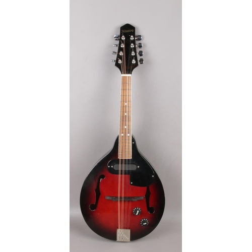 509 - A Maestro semi acoustic mandolin. With rosewood fretboard and cherry burst finish, 67cm total length...