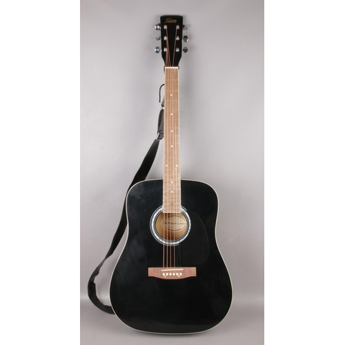 512 - A Swift black accoustic guitar with rosewood fretboard. With soft case and strap....