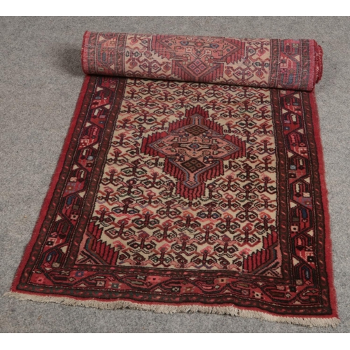 517 - A patterned carpet runner (approx 280cm x 85 cm)...