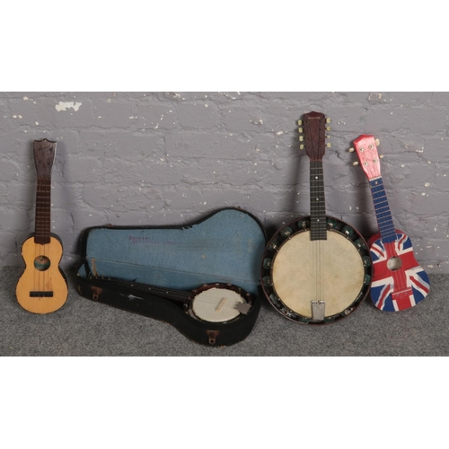 521 - A collection of Banjos....