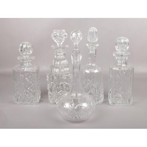 160 - Five cut glass spirit decanters....