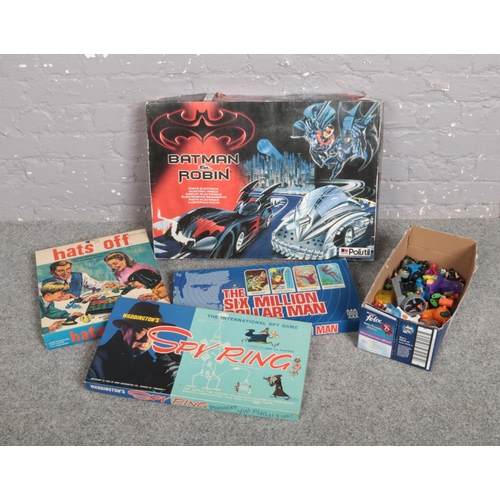 219 - A Polistil Batman & Robin racing set, along with three other boxed vintage games and a collection of...