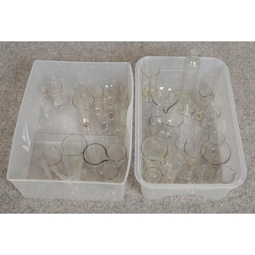279 - Two boxes of chemist measuring glass wares...