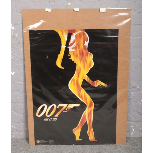 355 - A James Bond teaser film poster for The World Is Not Enough. (90cm x 64cm)....