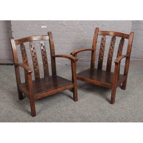 572 - A pair of mahogany nursing chairs....