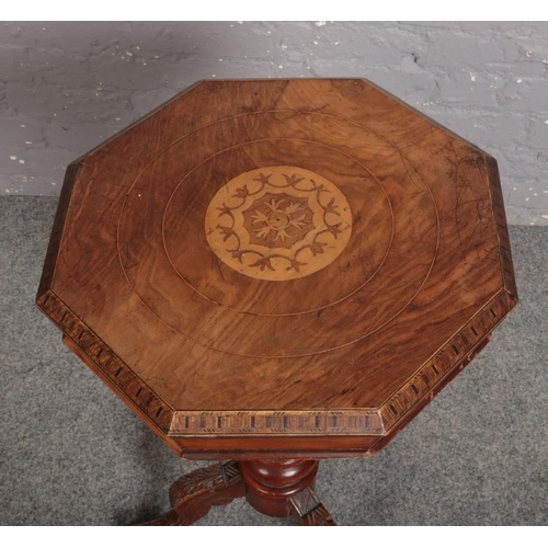 596 - A Victorian inlaid walnut centre pedestal work table, 78cm high....