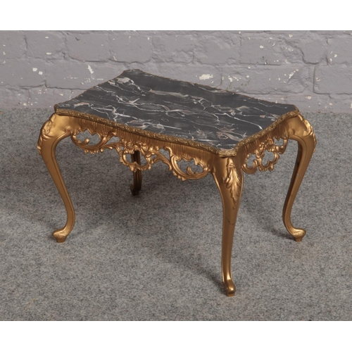 597 - A gilt metal and marble effect occasional table, 45cm x 29cm, 32cm high....