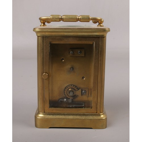 452 - A brass cased carriage clock. With Swiss 8 day movement having platform escapement, 14cm....