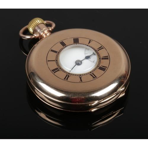 A 9ct gold H. Samuel half hunter pocket watch, cuvet also 9ct gold. 90g gross weight.