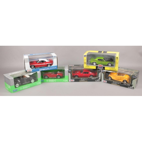 19 - Six boxed diecast model cars, 1:24 scale, to include Maista, Motor Max, Welly Nex and New Ray....
