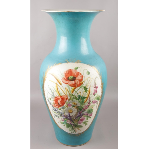 37 - A large 19th century French Sevres style vase, with hand painted panels depicting figures and flower...