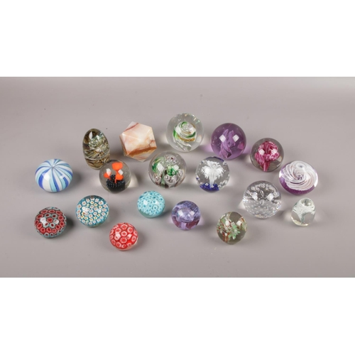 46 - A collection of mostly glass paperweights comprising of, A Caithness (Scotland)