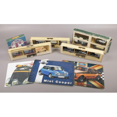 50 - A collection of boxed Lledo Days Gone diecast model vehicles, along with three modern metal automobi...