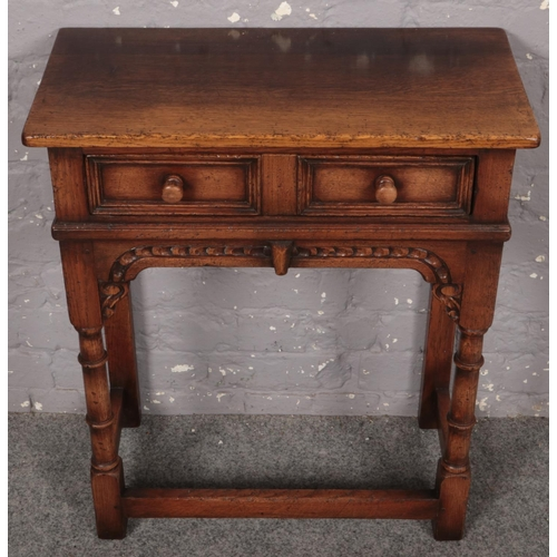 A Titchmarsh & Goodwin carved oak twin drawer side table. (71cm x 61cm)