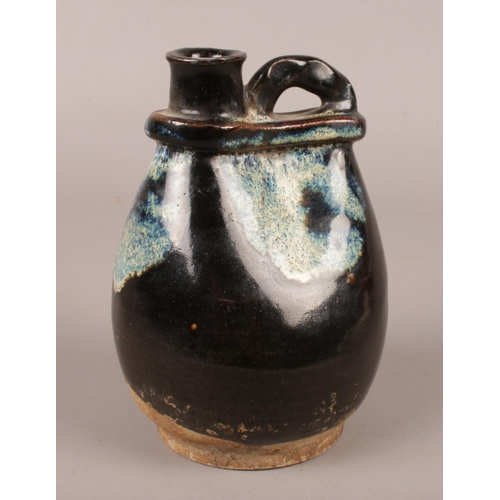 An antique Chinese phosphatic glaze vessel, possibly Tang dynasty. (Height 13cm).