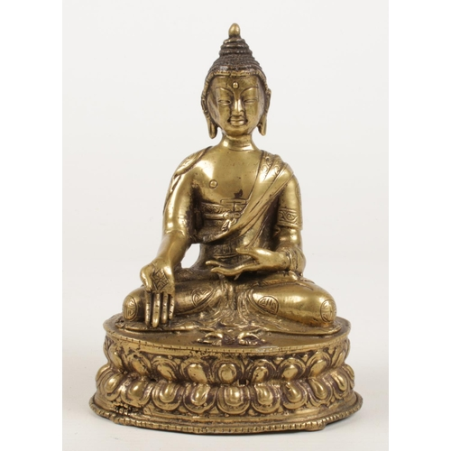A 19th century Sino Tibetan bronze devotional statue of a seated buddha raised on lotus plinth. H: 14cm