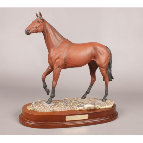 A Royal Doulton figure of 'Red Rum' DA218. Limited edition no 145 /7500 on wooden plinth. H: 35cm, W: 35cm.