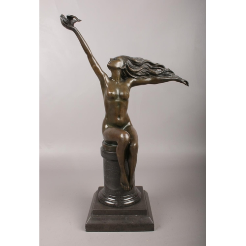 After Amadeo Gennarelli (1881-1943) bronze sculpture 'The Carrier Pigeon'' Bears foundry mark A1807 and signature. Raised on a marble column and stepped, square base, 43cm high.