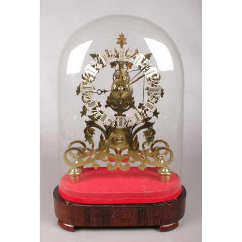 1 - An eight day Victorian brass fusee skeleton  mantel clock with silvered chapter ring. Housed under a...