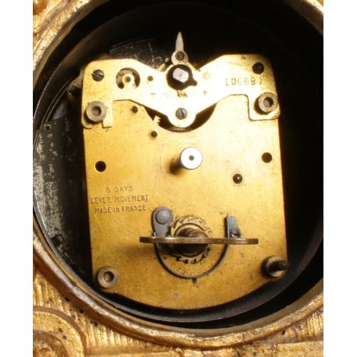 17 - A gilt metal eight day mantel clock, surmounting with nesting birds. 20cm tall.