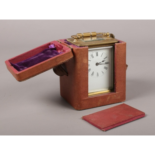 18 - A brass and glass carriage clock with leather travel case.