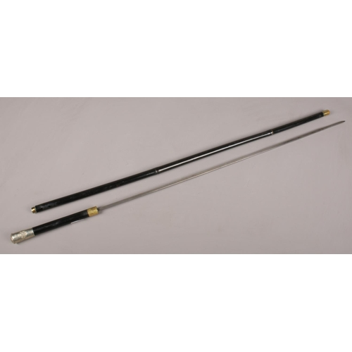 21 - An ebonised bamboo sword stick with Royal Flying Corps white metal pommel. Blade length 61cm.