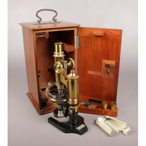23 - An early 20th century lacquered brass microscope by Otto Himmler, No. 13114. In mahogany case.