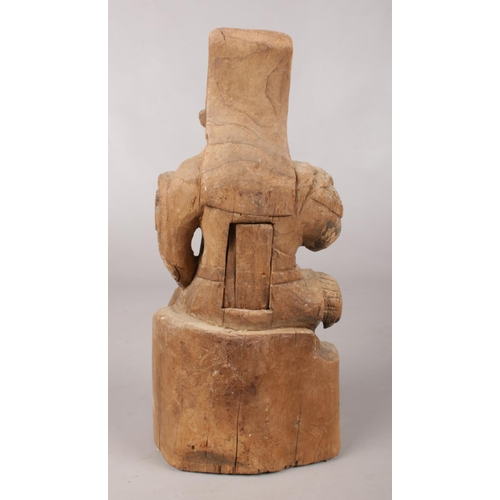 28 - A 19th century Chinese carved wooden figure, Guandi. 33cm.