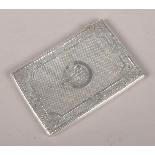 33 - A Victorian silver card case by Frederick Marston. Assayed Birmingham 1874. In original case.