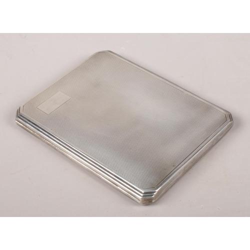 34 - A silver cigarette case. Assayed Birmingham 1947 by Deakin & Francis Ltd.