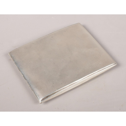 36 - A silver cigarette case. Assayed Sheffield 1930 by Walker & Hall.