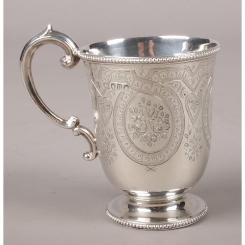 40 - A Victorian silver cup with engraved decoration. Assayed London 1875 by Martin, Hall & Co.