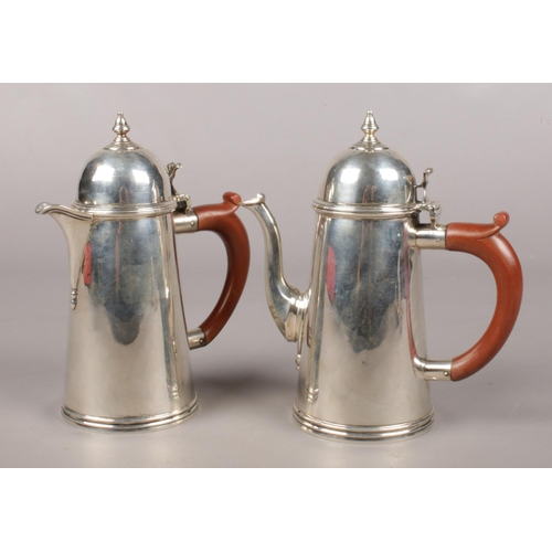 46 - A George V silver chocolate pot and hot water jug, Assayed London 1932 by Goldsmiths & Silversmiths ...