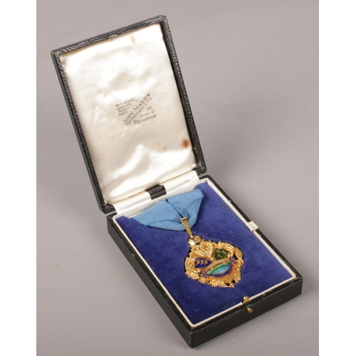 48 - A cased 9ct gold and enamel medal presented to Councillor T W Outram Mayor of The County Borough of ...