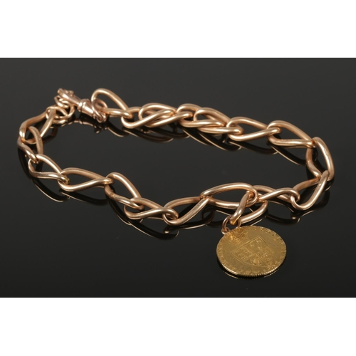 55 - A 1793 spade guinea on 15ct gold chain and 9ct gold clasp. Total weight 63g.