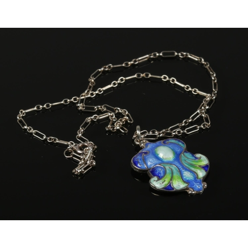 59 - An Art Nouveau silver and enamel pendant on silver chain.